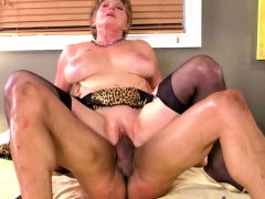 Milf in lingerie massages her lover