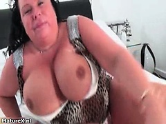 Nasty mature slut rubs her huge tits