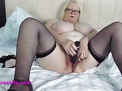 Sally removes her breathe hard and fucks her pussy