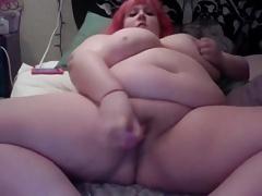 Strips and fucks her dildo